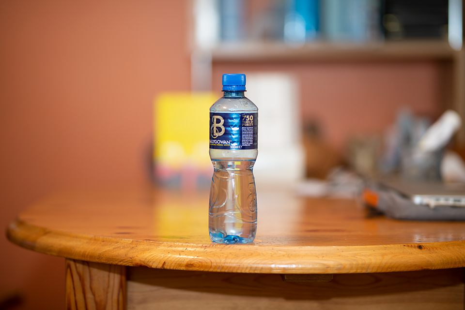 water bottle at F1.4 and 80 mm