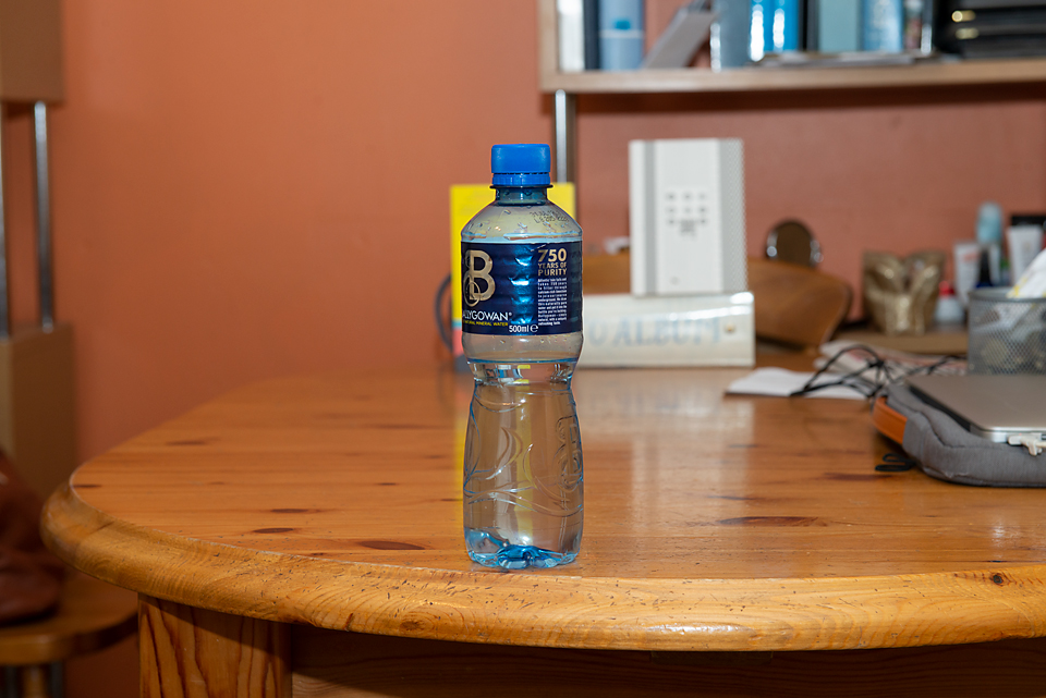 water bottle at F8 and 70 mm