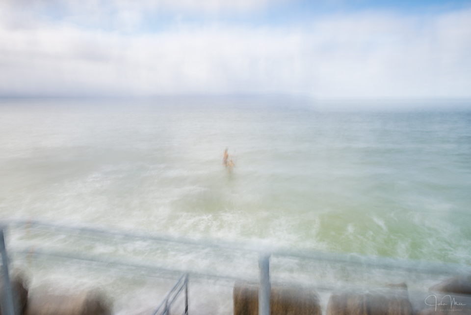 Woman in the sea at Silverstrand