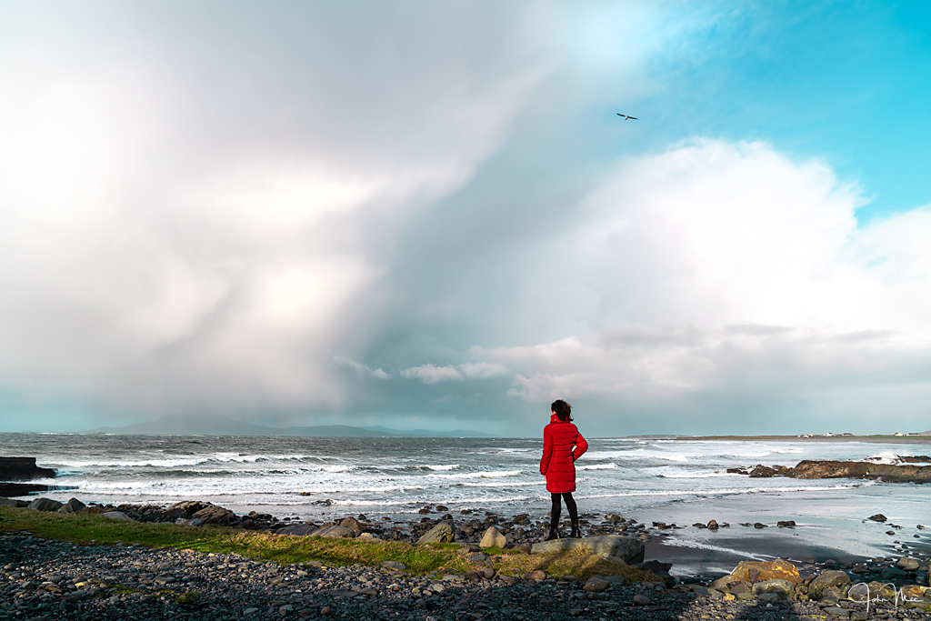 At the end of the Lost Valley, woman standing staring at the ocean