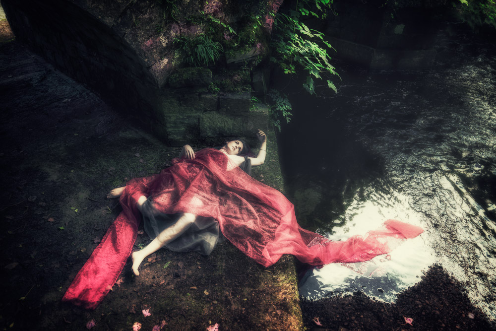 Dead girl in red on the ground